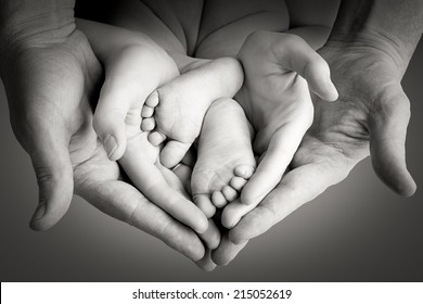 Family, mother with father holding baby legs, happy memory