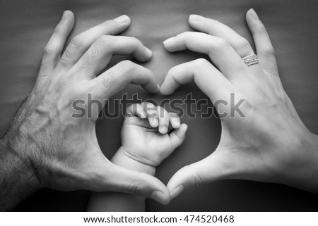 Family Mother Father Holding Baby Hand Stock Photo Edit Now