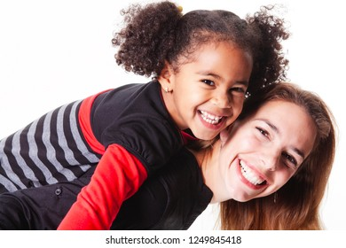 A family mother with girl child posing on a white background studio