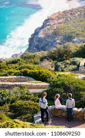 Family of mother and kids enjoying landscape of beautiful Cape of Good Hope in South Africa