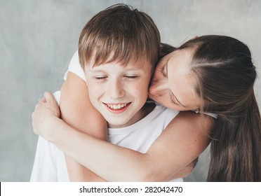 Family mother kiss son happy together close-up beautiful portrait