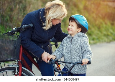 Family of mother and son biking
