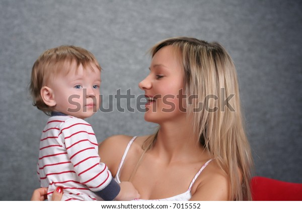 Family - mother takes care about cute kid