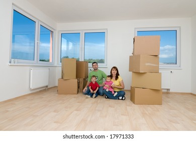 Family with moving boxes in new home.