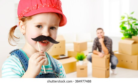 family moving home and renovation. funny child girl with a mustache foreman and father