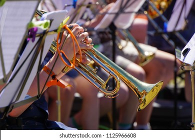 Family music festival in Detmold Town of Germany. Musical brass instruments and Children. Open-air Concert in the park. Beautiful Summer Sunny Day.