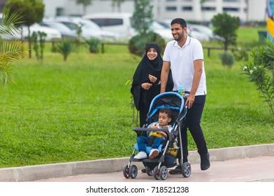 Family of Muslims from Iran stroll along the embankment of Batumi in the afternoon. Adjara, Batumi, September 2017