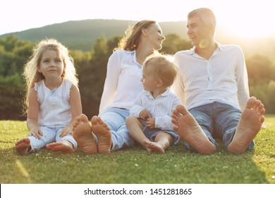 Family in nature. Parents with children have fun playing.
