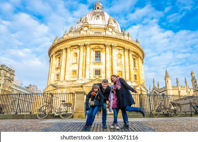 Family near Radcliffe camera in the morning, Oxford