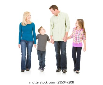 Family: Nuclear Family Parents And Kids Walk Holding Hands
