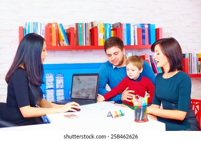 family in office, at the professional