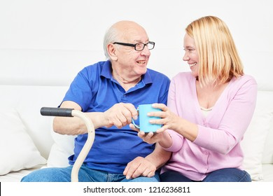 Family with old man as father and young woman at home care