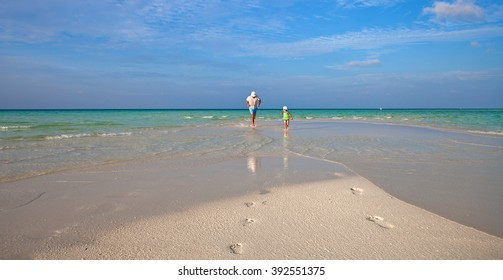 Family on the beach of Maldive Island