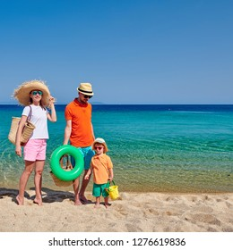Family on beach, young couple with three year old boy. Sithonia, Greece