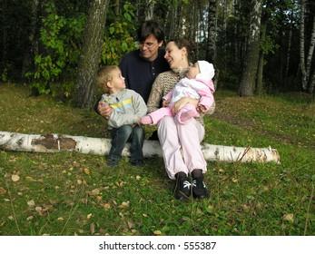 family on birch at autumn wood