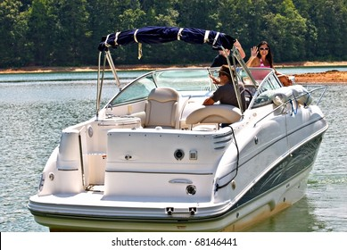 A family on a boat waving as they get ready to leave.