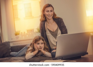 family on couch at home watching online tv shows
