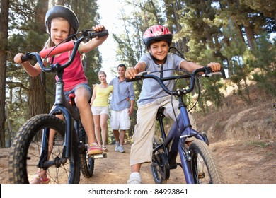 Family on country walk with bikes