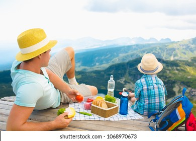 Family on a picnic in the mountains