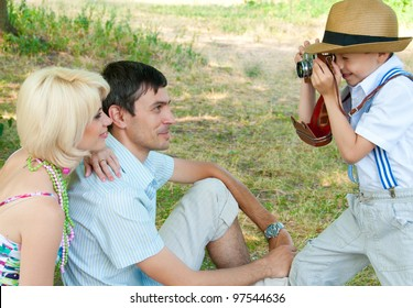 Family on a picnic. Son of photographs of parents mom and dad.