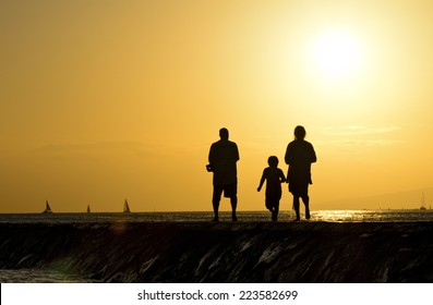 Family on Rocky Pier at sunset