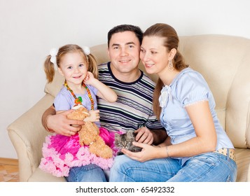 Family on a sofa , a white background