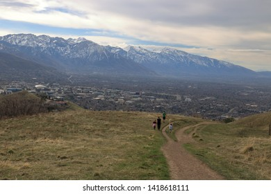 Family on a stroll in the foothills of the Wasatch enjoying views of downtown Salt Lake City