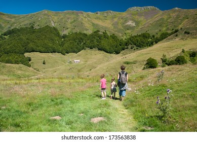 Family on a trekking day in the Auvergne mountains, Cantal, France