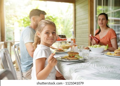 Family on vacation having outdoor lunch