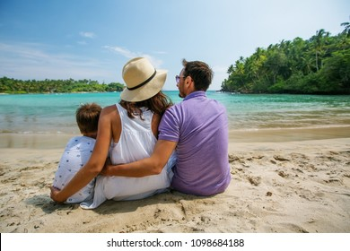 Family on vacation at the seashore of Indian ocean
