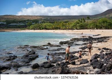 Family on Vacation, walking along Hulopoʻe Beach in Lanai, Hawaii