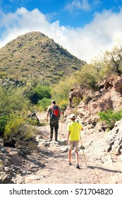 The family on the walk: the father and son are on the trail in the desert. Organ Pipe Cactus National Monument, Arizona