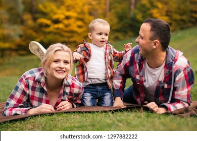 Family on weekend. Mother father and son in park