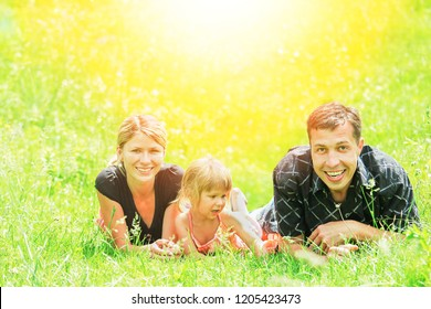 Family outdoors playing in the park on the grass