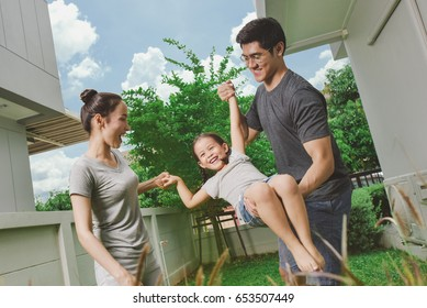 Family outside together on a nice day at home