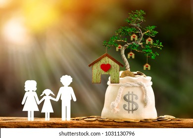 Family with paper art and coin in a money bag and grow to a tree produce house put on the wood, Save money or loan for business investment real estate of owner in the future and buy a new home concept
