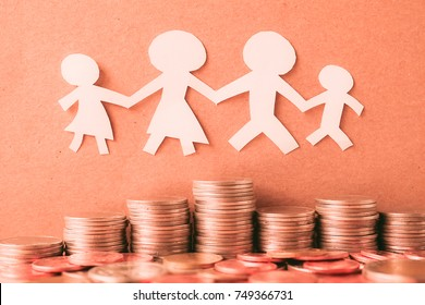 family paper model and row of coin for finance about family concept