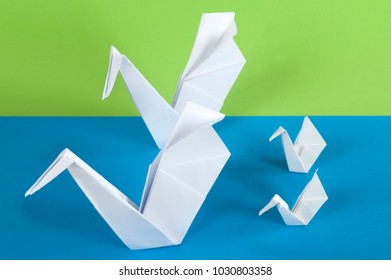 family of paper swans