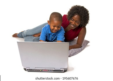 Family: Parent Helping Child Learn About Computer