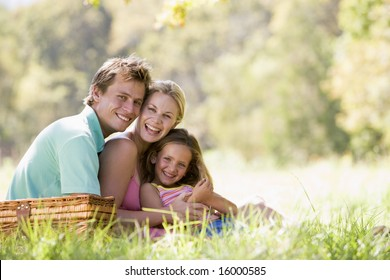 Family at park having a picnic and laughing