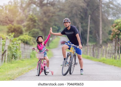 family in the park on bicycles.