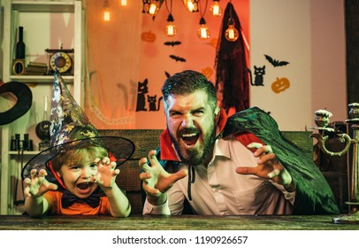 Family party on Halloween. Man and boy scare guests. Father and son playing scary Halloween games at home. Funny friends, happy childhood.