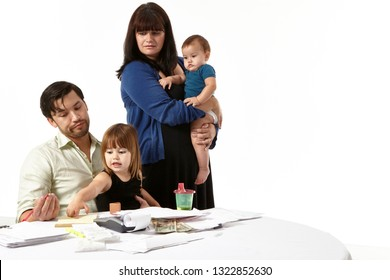 Family paying bills.  Mixed race American family struggling to make ends meet as they stress about paying bills. isolated. Asian dad is worried about bills as his wife and children look on