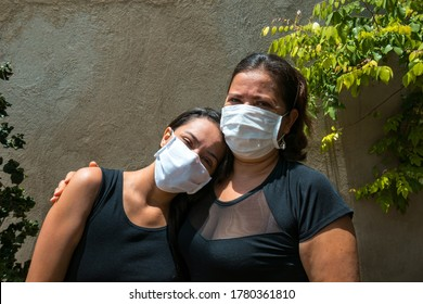 Family photo of Mother and Daughter with face mask Hugging in the park