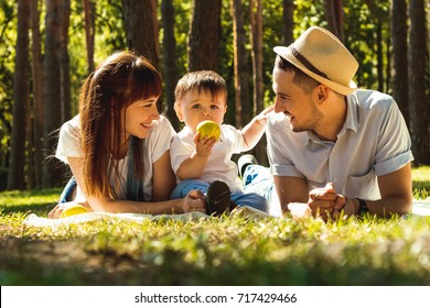 Family at a picnic. Happy beautiful family having fun in park. Summer, autumn concept.