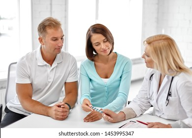 family planning, medicine and healthcare concept - couple visiting doctor at fertility clinic