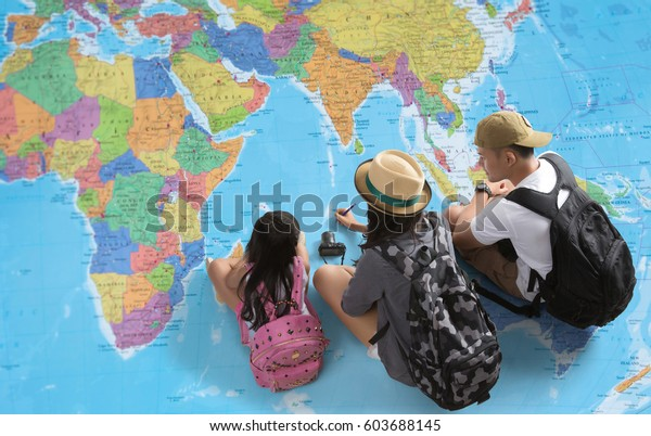 The family is planning a trip around the world.They're looking at a world map
