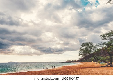 A Family At Play On Big Beach At Makena State Park With Molokini In The Background On The Island Of Maui
