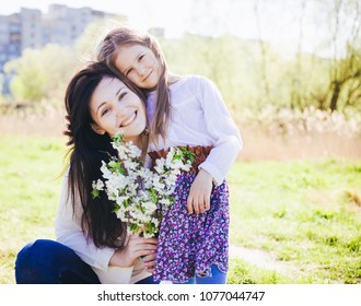 Family play outdoors . smile couple portrait