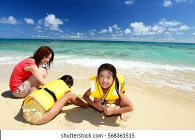 Family playing at the beach